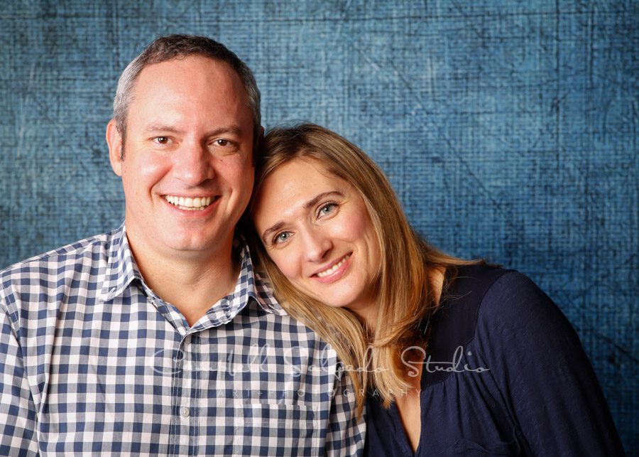 Portrait of couple on denim background by family photographers at Campbell Salgado Studio in Portland, Oregon.