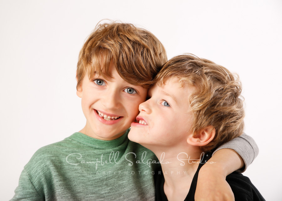 Portrait of boys on white background by children's photographers at Campbell Salgado Studio in Portland, Oregon.