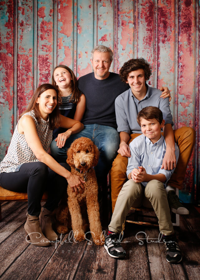 Portrait of family on Italian rust background by family photographers at Campbell Salgado Studio in Portland, Oregon.
