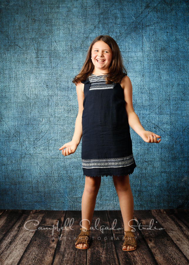 Portrait of girl on denim background by family photographers at Campbell Salgado Studio in Portland, Oregon.