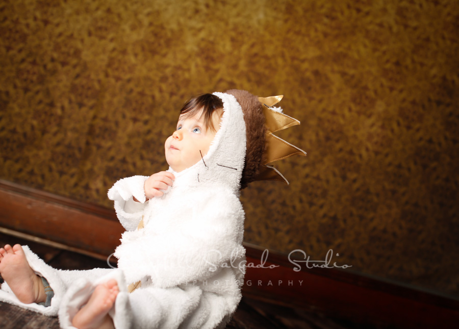 Portrait of child on amber light background by child photographers at Campbell Salgado Studio in Portland, Oregon.