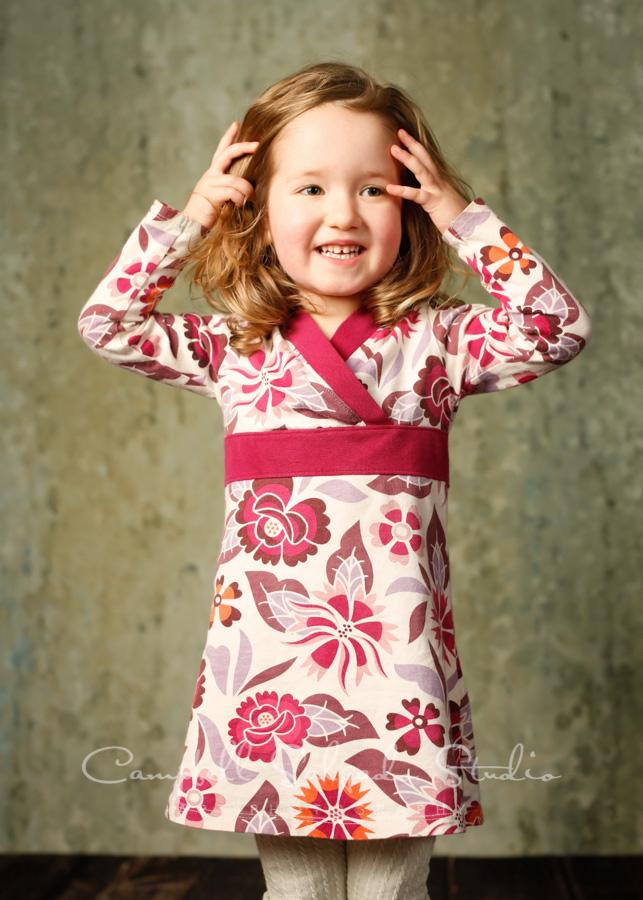Portrait of child on rain dance background by child photographers at Campbell Salgado Studio in Portland, Oregon.
