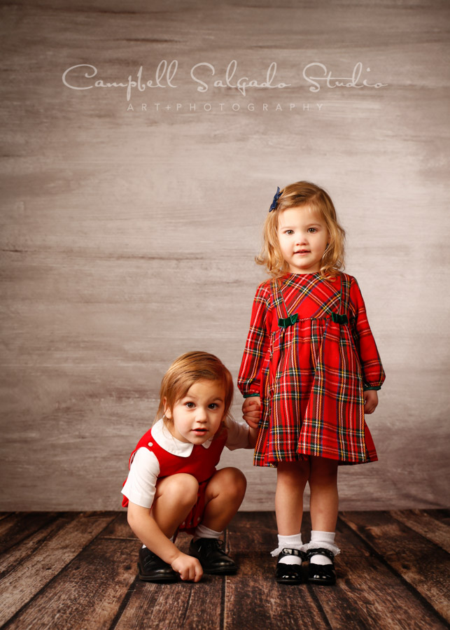 Portrait of twins on graphite background by child photographers at Campbell Salgado Studio in Portland, Oregon.