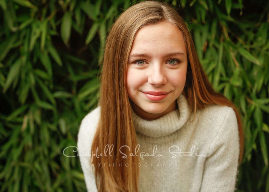 Portrait of girl on bamboo background by child photographers Campbell Salgado Studio in Portland, Oregon.