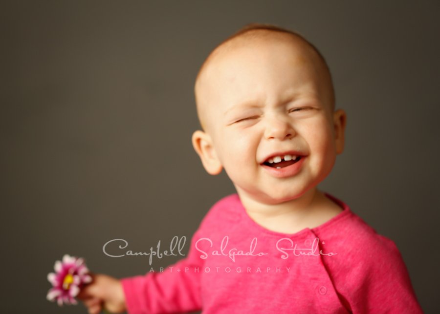 Portrait of child on grey background by family photographers at Campbell Salgado Studio in Portland, Oregon.