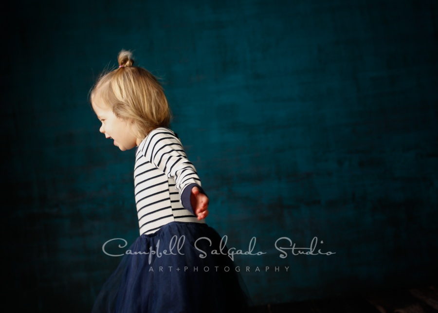 Portrait of girl on deep ocean background by child photographers at Campbell Salgado Studio in Portland, Oregon.