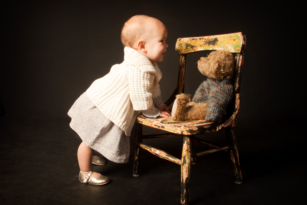 One year old baby girl portrait taken by baby photographers at Campbell Salgado Studio in Portland, Oregon.