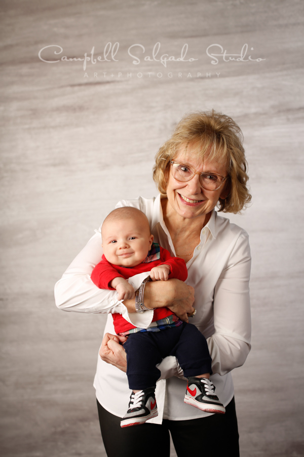 Portrait of baby and grandma on graphite background by baby photographers at Campbell Salgado Studio in Portland, Oregon.