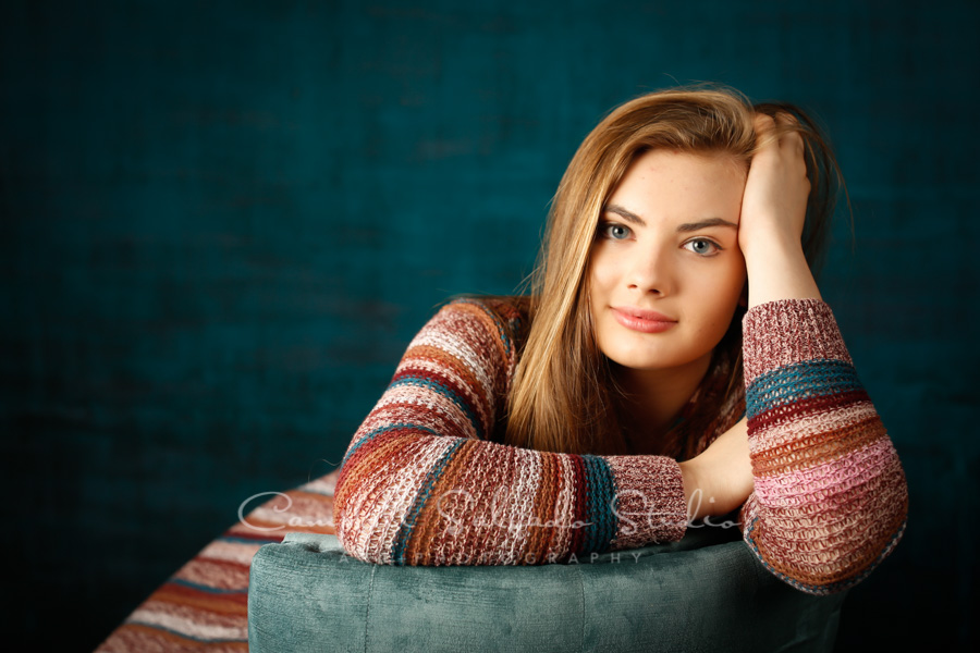 Portrait of teen on deep ocean background by teen photographers at Campbell Salgado Studio in Portland, Oregon.