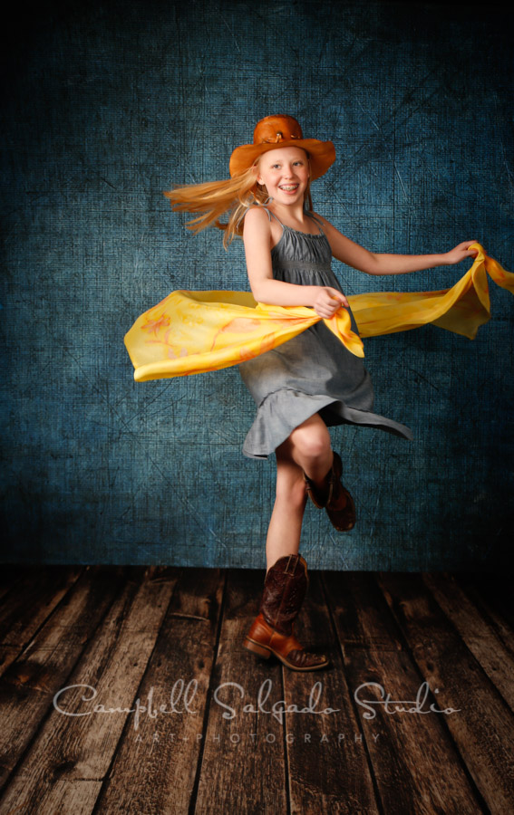 Portrait of girl on denim background by child photographers at Campbell Salgado Studio in Portland, Oregon.