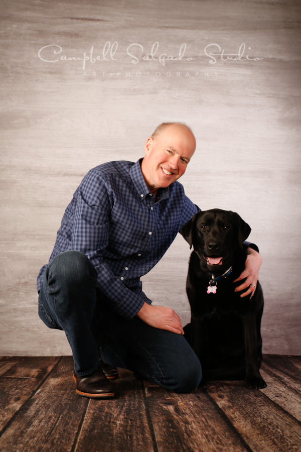 Portrait of man and dog on graphite background by pet photographers at Campbell Salgado Studio in Portland, Oregon.