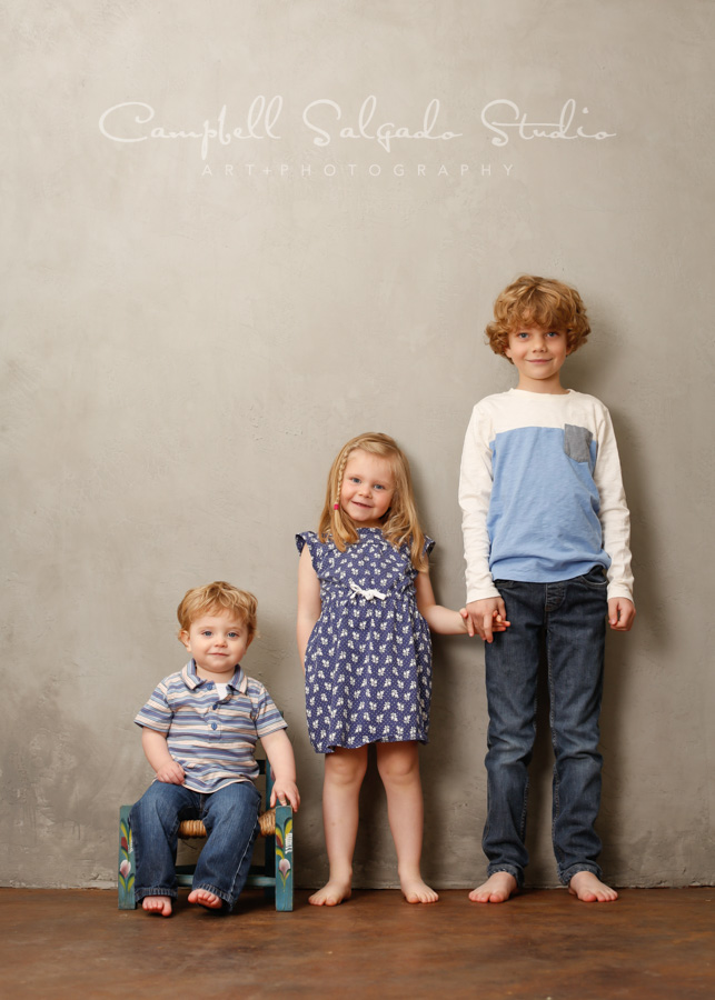 Portrait of children on modern gray background by children's photographers at Campbell Salgado Studio in Portland, Oregon.