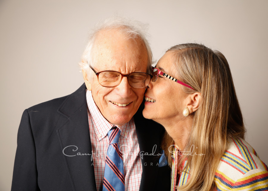 Portrait of couple on light gray background by couples photographers at Campbell Salgado Studio in Portland, Oregon.