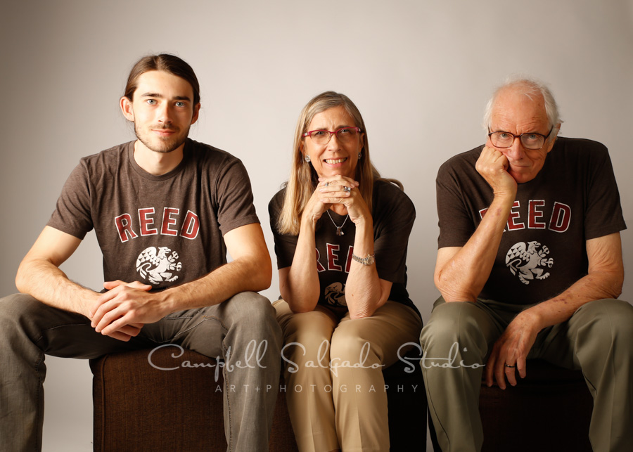 Portrait of family on light gray background by family photographers at Campbell Salgado Studio in Portland, Oregon.
