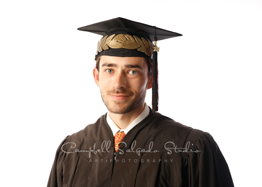 Portrait of graduate on white background by individual photographers at Campbell Salgado Studio in Portland, Oregon.