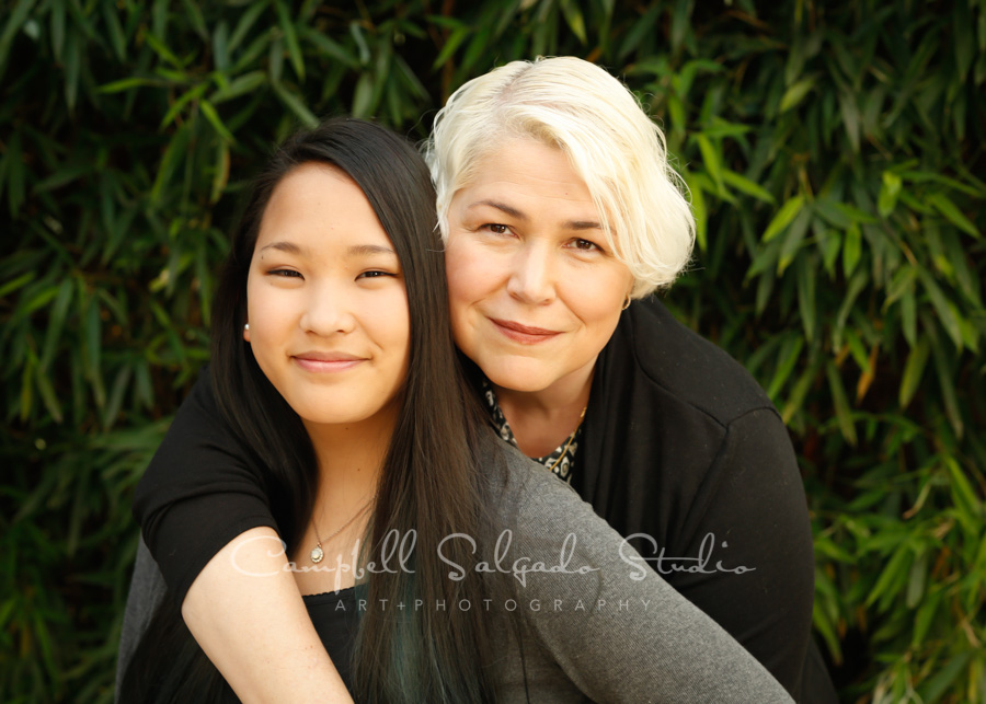 Portrait of mother and daughter on bamboo background by family photographers at Campbell Salgado Studio in Portland, Oregon.