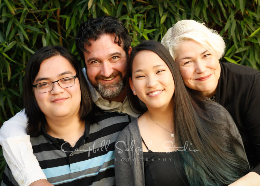 Portrait of familyr on bamboo background by family photographers at Campbell Salgado Studio in Portland, Oregon.