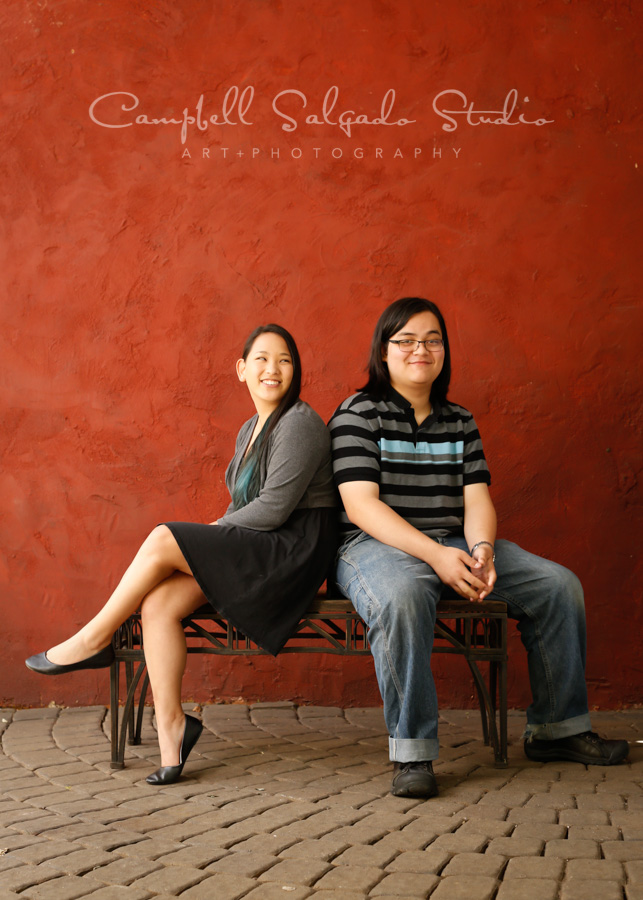 Portrait of teens on red stucco background by teen photographers at Campbell Salgado Studio in Portland, Oregon.