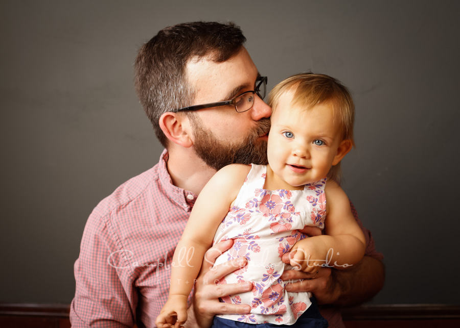 Portrait of father and daughter on grey background by family photographers at Campbell Salgado Studio in Portland, Oregon.