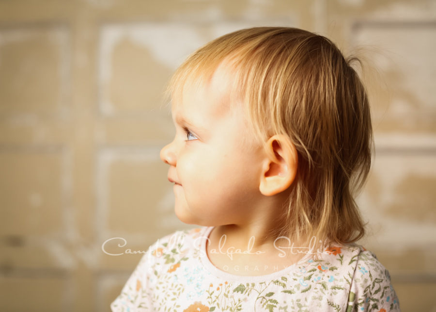 Portrait of toddler on antique white doors background by child photographers at Campbell Salgado Studio in Portland, Oregon.