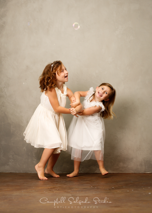 Portrait of children on modern grey background by childrens photographers at Campbell Salgado Studio in Portland, Oregon.