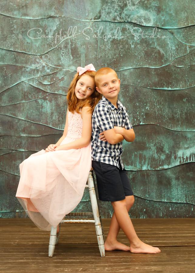 Portrait of kids on ocean weave background by childrens photographers at Campbell Salgado Studio in Portland, Oregon.