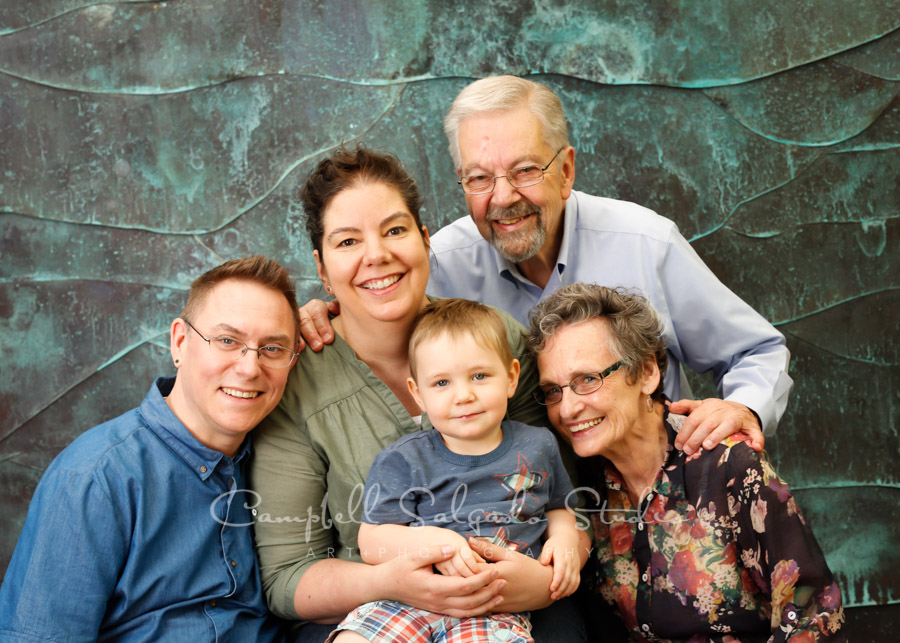 Portrait of multi-generational family on ocean weave background by family photographers at Campbell Salgado Studio in Portland, Oregon.