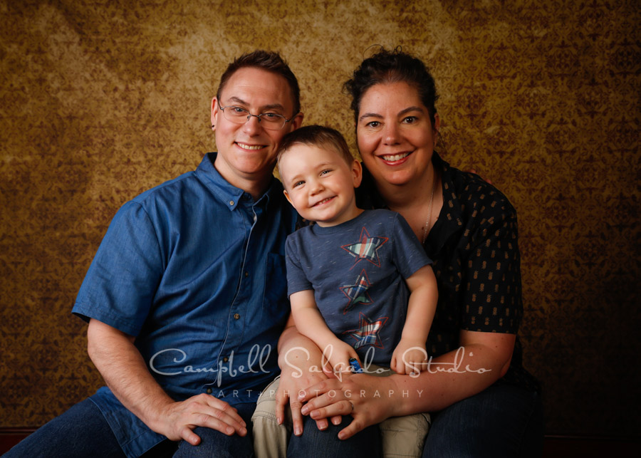 Portrait of family on amber light background by family photographers at Campbell Salgado Studio in Portland, Oregon.
