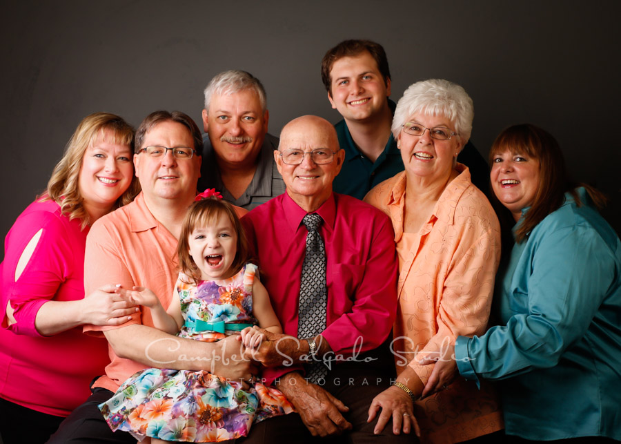 Portrait of multi-generational family on grey background by family photographers at Campbell Salgado Studio in Portland, Oregon.