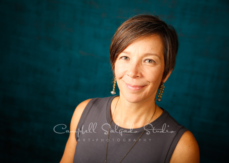Portrait of woman on deep ocean background by individual photographers at Campbell Salgado Studio in Portland, Oregon.