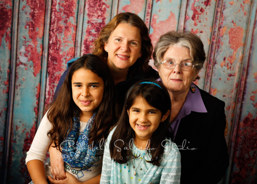 Portrait of multi-generational family on Italian rust background by family photographers at Campbell Salgado Studio in Portland, Oregon.