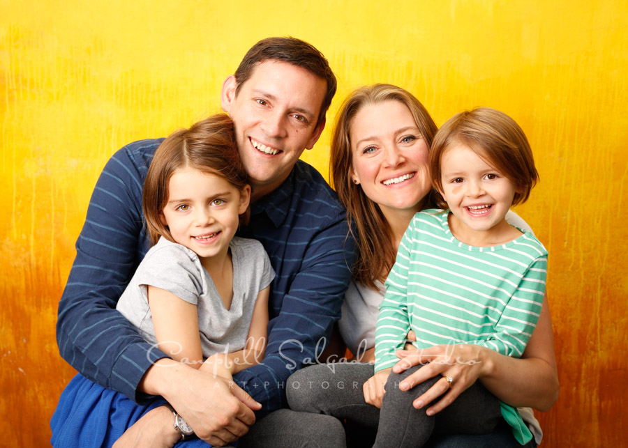 Portrait of family on liquid sunshine background by family photographers at Campbell Salgado Studio in Portland, Oregon.