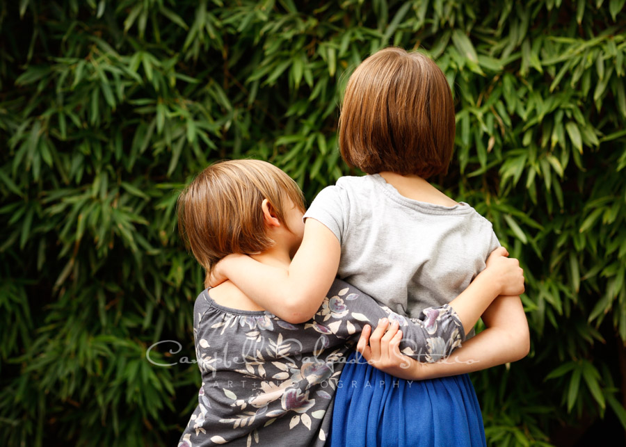 Portrait of girls on bamboo background by family photographers at Campbell Salgado Studio in Portland, Oregon.