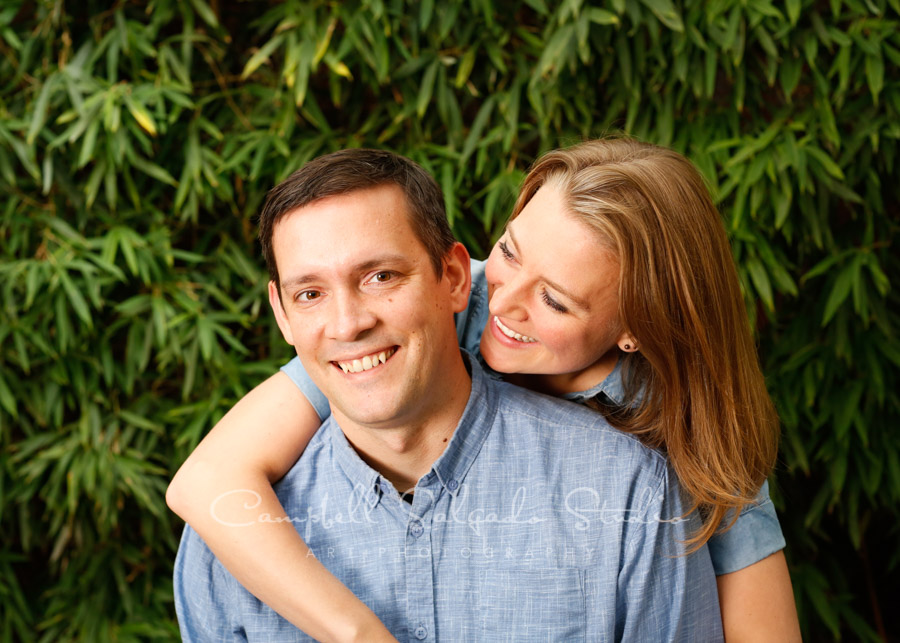 Portrait of couple on bamboo background by family photographers at Campbell Salgado Studio in Portland, Oregon.