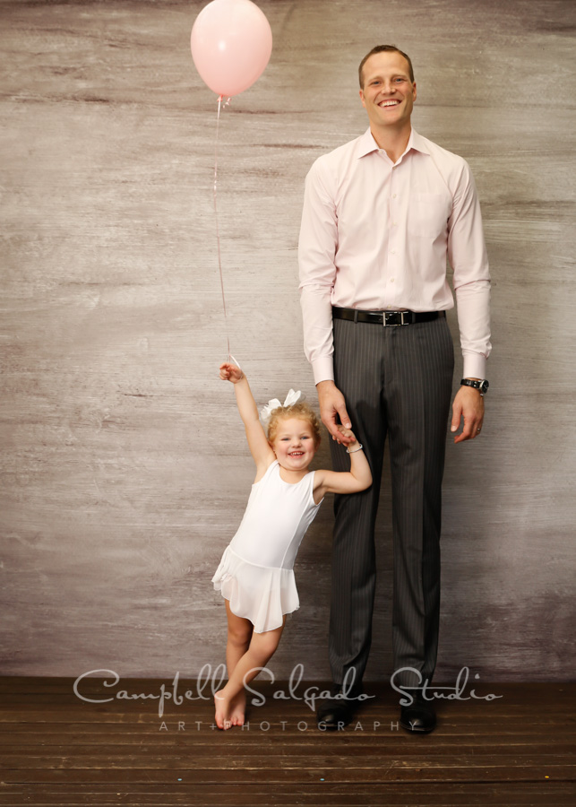 Portrait of father and daughter on graphite background by family photographers at Campbell Salgado Studio in Portland, Oregon.
