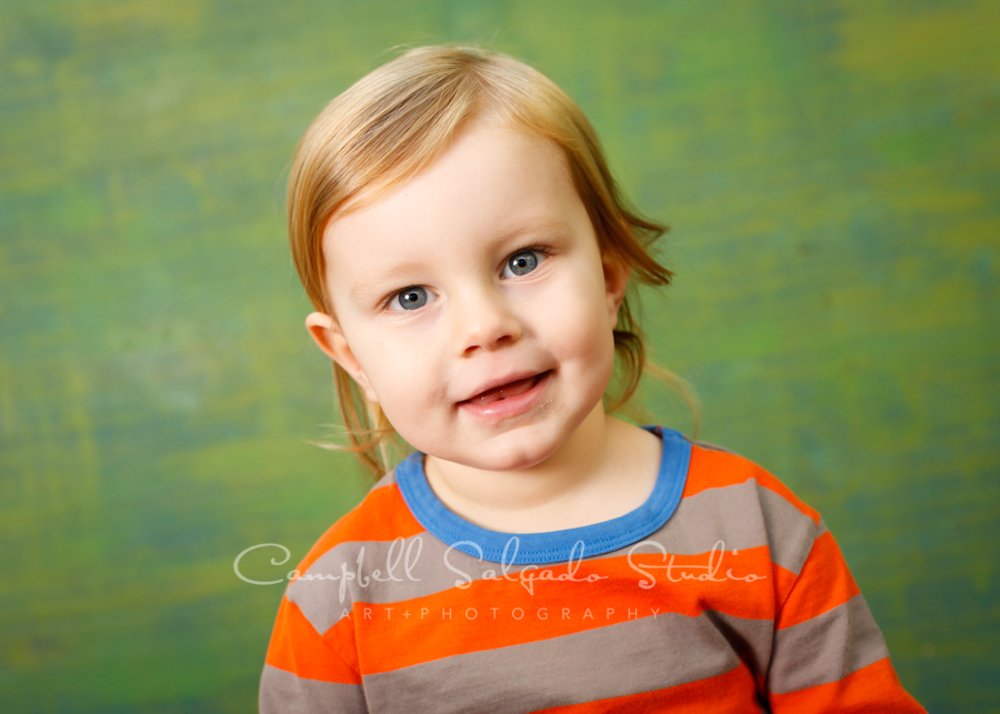 Portrait of boy on blue green weave background by child photographers at Campbell Salgado Studio in Portland, Oregon.