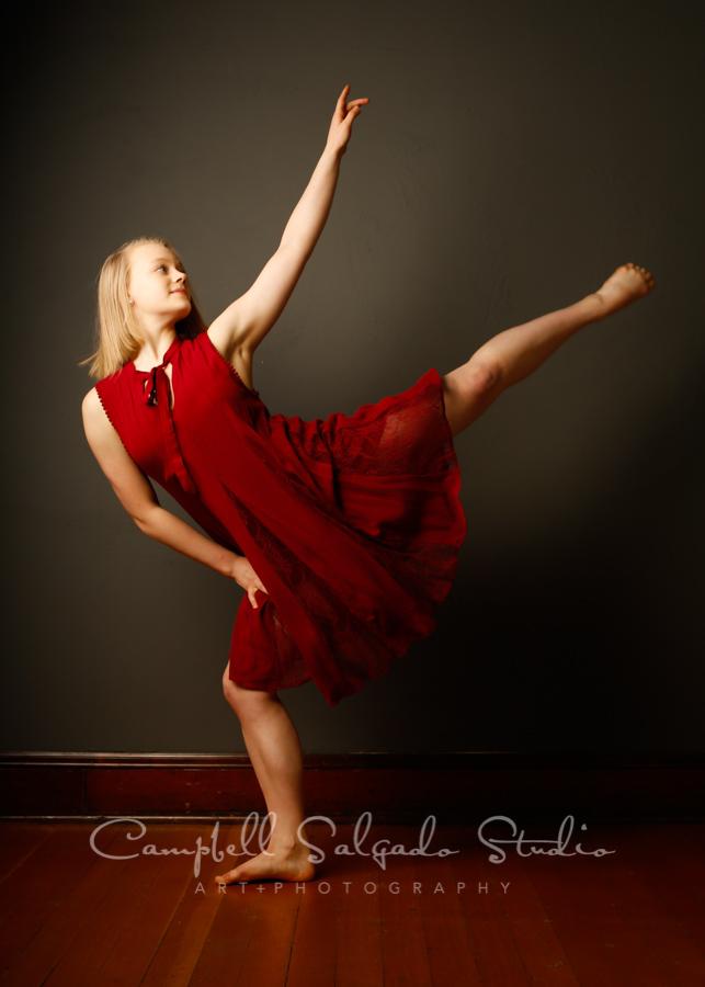 Portrait of teenage dancer on grey background by teen photographers at Campbell Salgado Studio in Portland, Oregon.