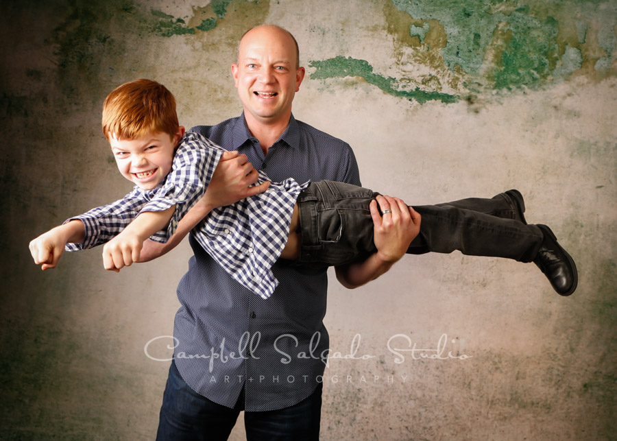 Portrait of father and son on abandoned concrete background by family photographers at Campbell Salgado Studio in Portland, Oregon.