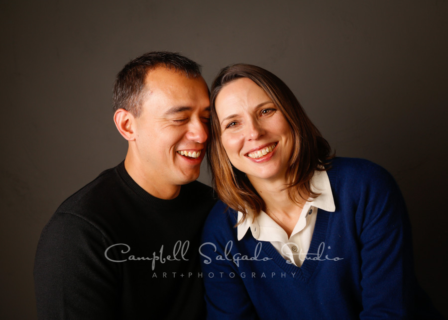 Portrait of couple on grey background by couples photographers at Campbell Salgado Studio in Portland, Oregon.
