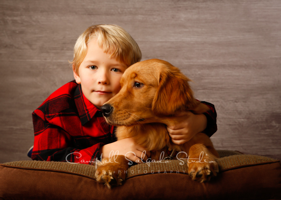 Portrait of boy and dog on graphite background by children's photographer at Campbell Salgado Studio in Portland, Oregon.