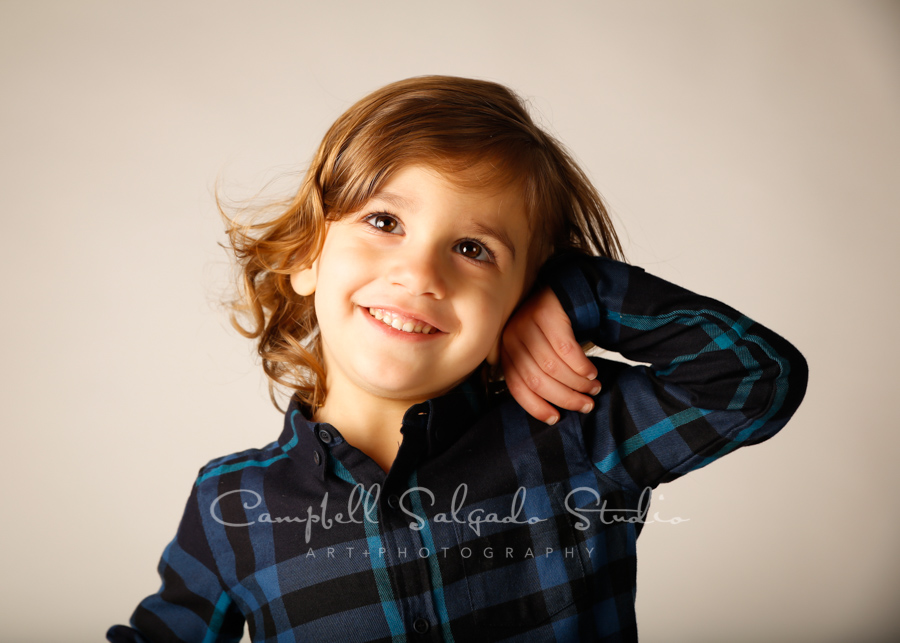 Portrait of twin toddler on light grey background by child photographers at Campbell Salgado Studio in Portland, Oregon.