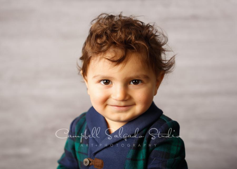Portrait of toddler on graphite background by children's photographers at Campbell Salgado Studio in Portland, Oregon.