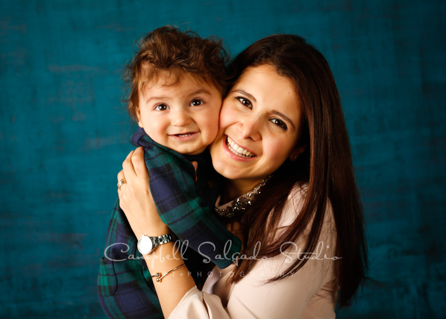 Portrait of mother and son on deep ocean background by family photographers at Campbell Salgado Studio in Portland, Oregon.