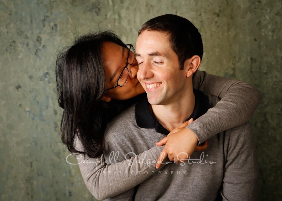 Portrait of couple on rain dance background by couple's photographers at Campbell Salgado Studio in Portland, Oregon.