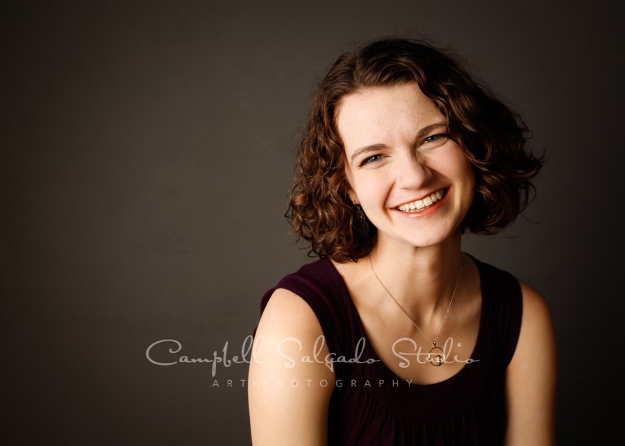 Portrait of girl on grey background by family photographers at Campbell Salgado Studio in Portland, Oregon.
