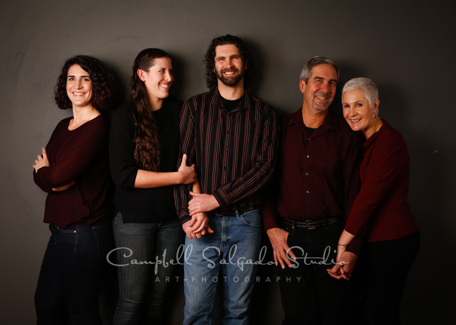 Portrait of family on gre background by family photographers at Campbell Salgado Studio in Portland, Oregon.