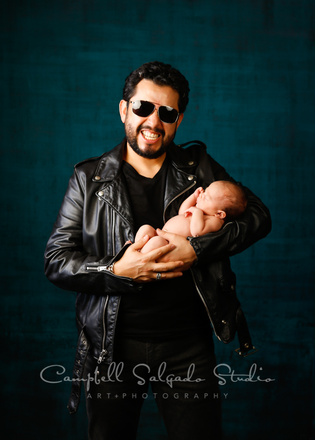 Portrait of father and newborn on deep ocean background by newborn photographers at Campbell Salgado Studio in Portland, Oregon.