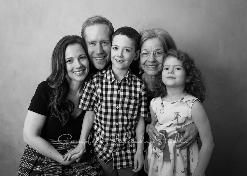 Black and white portrait of multi generational family on modern grey background by family photographer at Campbell Salgado Studio in Portland, Oregon.