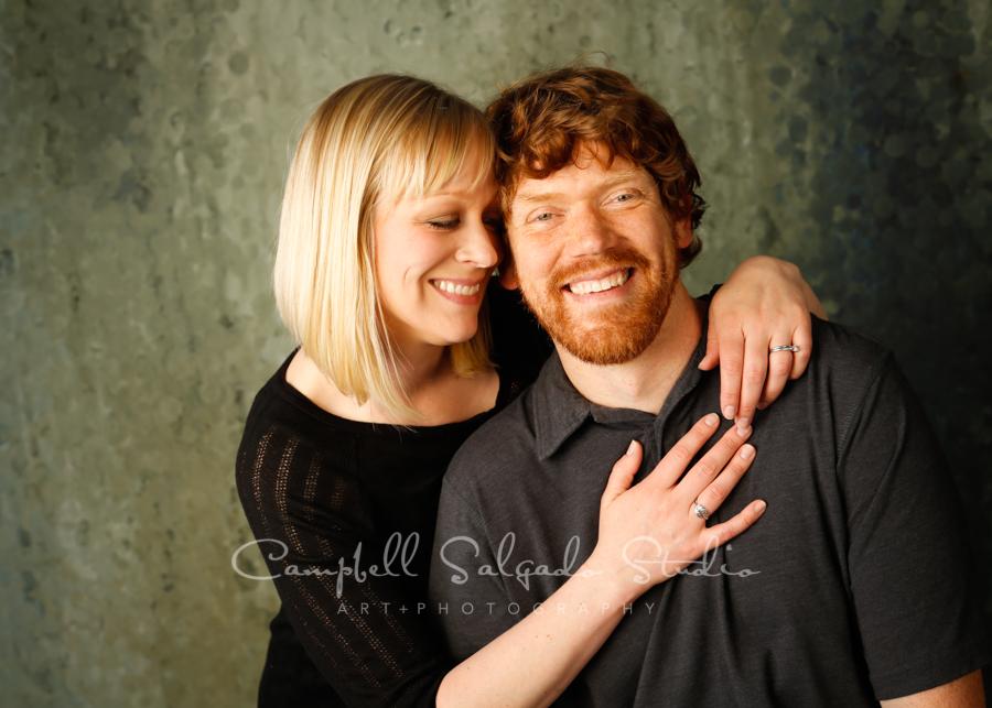 Portrait of couple on rain dance background by couples photographers at Campbell Salgado Studio in Portland, Oregon.