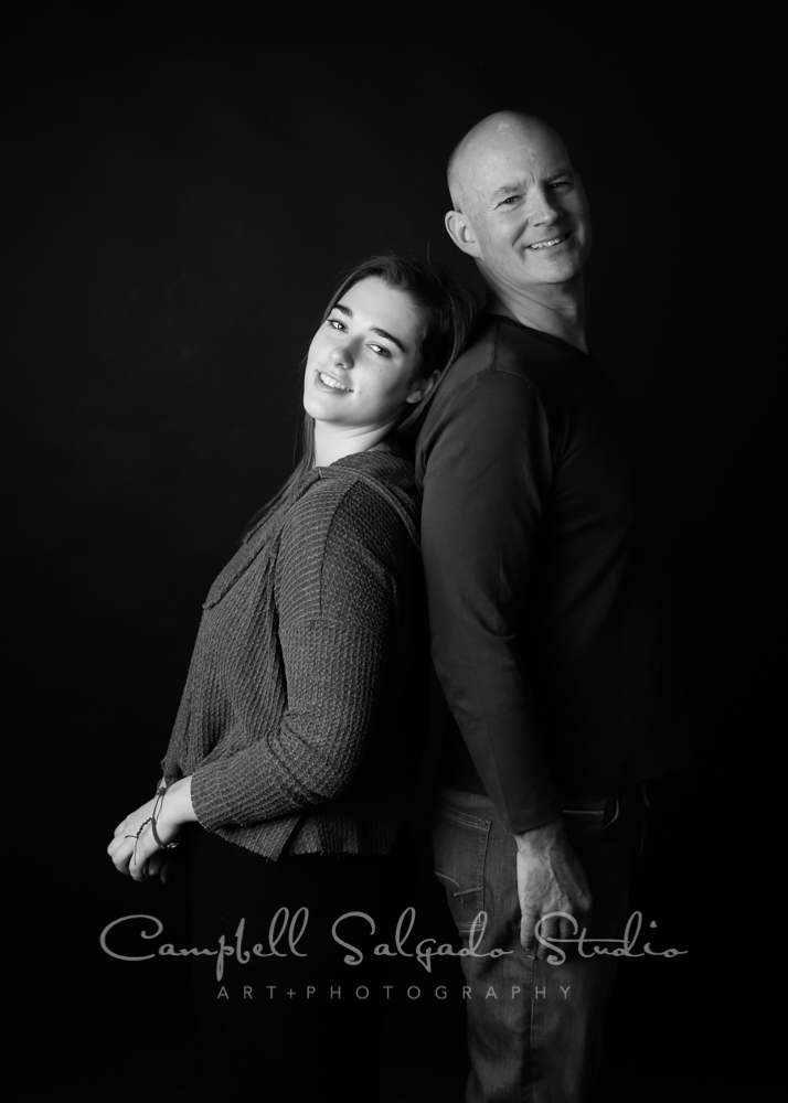 Portrait of father and daughter on black background by family photographers at Campbell Salgado Studio in Portland, Oregon.